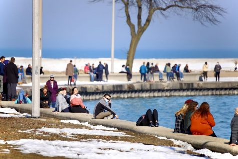Residents out on the Lakefront Trail as temperatures reach 54 degrees in Chicago following weeks of bitter cold and heavy snowfall