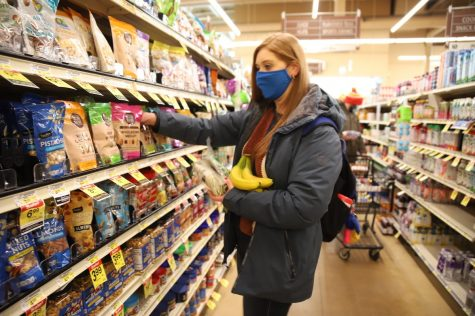 Piper DeYoung finds snacks on sale at a Lakeview Jewel-Osco on Feb. 19, 2021.