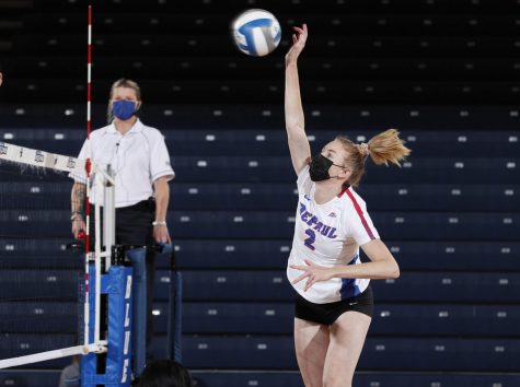 DePaul senior Emma Price goes up for spike during a match against Xavier on Saturday at McGrath-Phillips Arena.