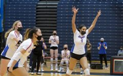 The DePaul volleyball team celebrates after winning a point against Butler.