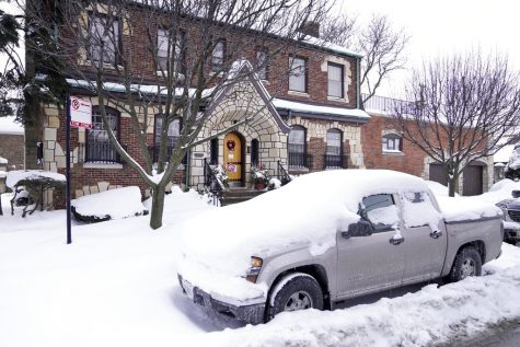 A snow covered truck sits outside the home of former Illinois House Speaker Michael Madigan Thursday, Feb. 18, 2021, near Midway International Airport in Chicago. Madigan announced his resignation from the Illinois House Thursday, after representing a Southwest Side Chicago area district for a half-century. (AP Photo/Charles Rex Arbogast)