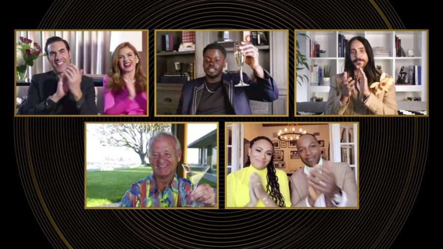 In this video grab issued Sunday, Feb. 28, 2021, by NBC, nominees in the category for best supporting actor in a motion picture react as Daniel Kaluuya, top center, is announced as the winner for his role in