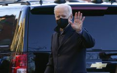 President Joe Biden waves as he arrives for Mass at Holy Trinity Catholic Church in the Georgetown neighborhood of Washington, Saturday, March 6, 2021. (AP Photo/Patrick Semansky)