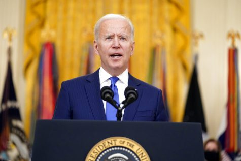 President Joe Biden speaks during an event to mark International Women