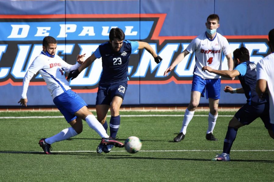 DePaul men's soccer players look to win the ball back from a Marquette player on Saturday at Wish Field.