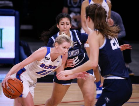 DePaul junior guard Lexi Held looks to go past a Villanova defender on Jan. 4 at Wintrust Arena.
