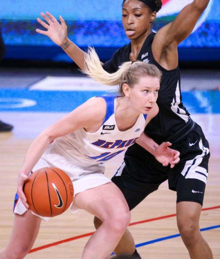 DePaul junior guard Lexi Held looks to get past a Butler player on Monday at Wintrust Arena.