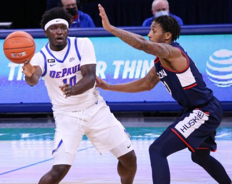DePaul senior guard Ray Salnave passes the ball against UConn on Jan. 11 at Wintrust Arena.
