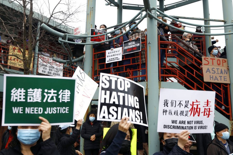 Demonstrators holding signs take part in a rally against Asian hate crimes, Saturday, March 27, 2021 at Chinatown in Chicago. The gathered crowd demanded justice for the victims of the Atlanta spa shooting and for an end to racism, xenophobia and misogyny. (AP Photo/Shafkat Anowar)