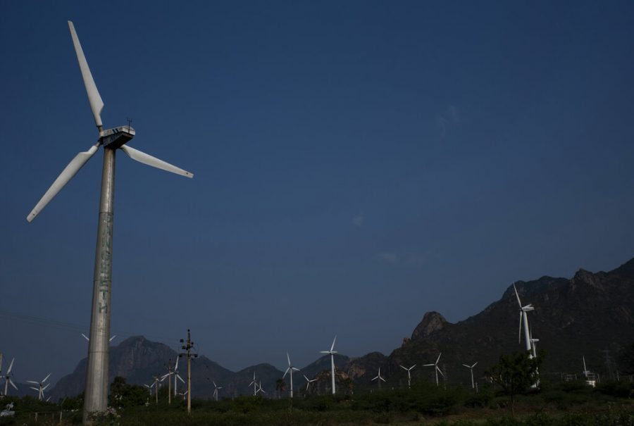 Three-bladed wind turbines at one of Asia's largest wind farms are seen in the backdrop of Western Ghats at Aralvaimozhi, southern Tamil Nadu state, India, Friday, April 2, 2021. (AP Photo/R S Iyer)