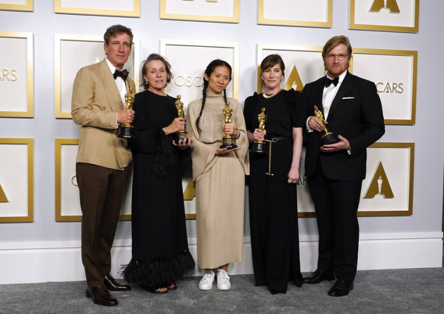 Producers Peter Spears, from left, Frances McDormand, Chloe Zhao, Mollye Asher and Dan Janvey, winners of the award for best picture for
