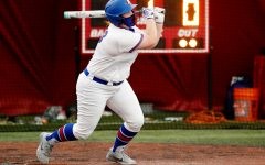 DePaul junior Gabby O'Riley hits the ball during the Blue Demons first series in February.