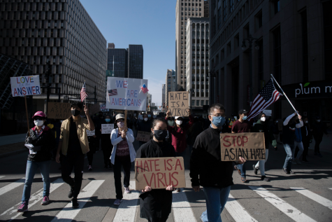 People march during the second consecutive weekend of Stop Asian Hate protests, Saturday March 27, 2021, on Woodward Avenue in Detroit.