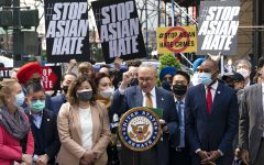 Senate Majority Leader Chuck Schumer, D-N.Y., center, is joined by U.S. Rep. Grace Meng, D-N.Y., third from left, at a news conference to discuss an Asian-American hate crime bill, Monday, April 19, 2021, in New York. Schumer is pushing for passage of the COVID-19 Hate Crimes Act in the Senate. (AP Photo/Mark Lennihan)