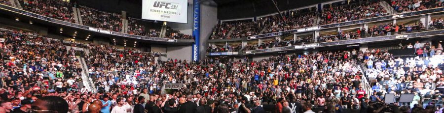 Fans attend the UFC 261 mixed martial arts event Saturday, April 24, 2021, in Jacksonville, Fla. The sold-out event touted as the first full-capacity sporting event held indoors in more than a year drew a star-studded crowd. (AP Photo/Gary McCullough)