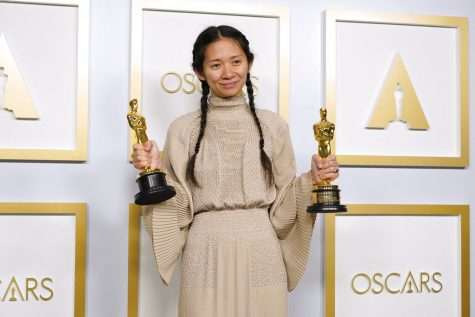 "Chloe Zhao, winner of the awards for best picture and director for ""Nomadland,"" poses in the press room at the Oscars on Sunday, April 25, 2021, at Union Station in Los Angeles. (AP Photo/Chris Pizzello, Pool)"