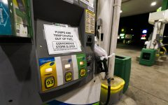 A pump at a gas station in Silver Spring, Md., is out of service, notifying customers they are out of fuel, Thursday, May 13, 2021. Motorists found gas pumps shrouded in plastic bags at tapped-out service stations across more than a dozen U.S. states Thursday while the operator of the nations largest gasoline pipeline reported making substantial progress in resolving the computer hack-induced shutdown responsible for the empty tanks. (AP Photo/Manuel Balce Ceneta)