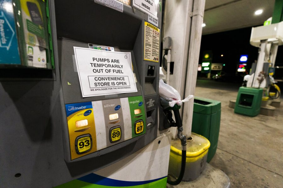 A pump at a gas station in Silver Spring, Md., is out of service, notifying customers they are out of fuel, Thursday, May 13, 2021. Motorists found gas pumps shrouded in plastic bags at tapped-out service stations across more than a dozen U.S. states Thursday while the operator of the nation's largest gasoline pipeline reported making