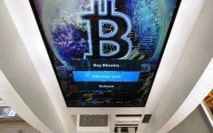 FILE - In this Feb. 9, 2021 file photo, the Bitcoin logo appears on the display screen of a crypto currency ATM at the Smoker's Choice store in Salem, N.H.  The price of Bitcoin fell as much as 29% Wednesday, May 19 after the China Banking Association warned members of risks associated with digital currencies. Other digital currencies suffered sharp declines as well.  (AP Photo/Charles Krupa, File)