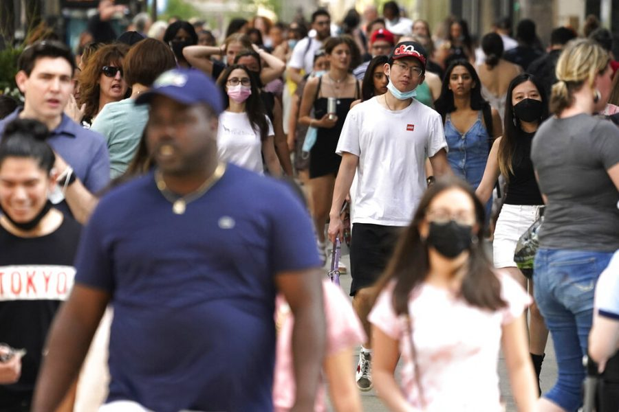 Pedestrians walk along a shopping district on Michigan Avenue in downtown Chicago on Saturday, May 22, 2021. Chicago will no longer require masks for fully vaccinated people in most settings following similar changes from the state of Illinois and new guidance from the U.S. Centers for Disease Control and Prevention. (AP Photo/Nam Y. Huh)