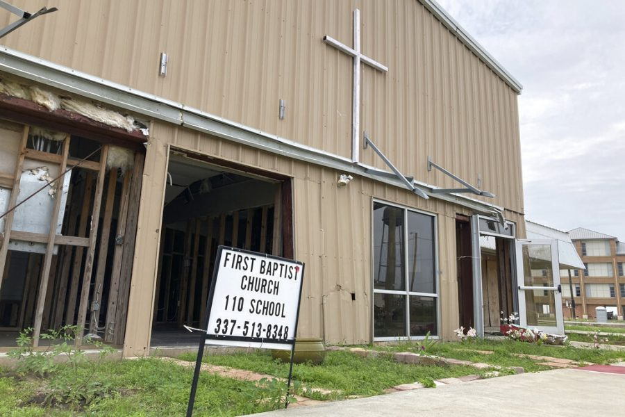 The+exterior+of+the+First+Baptist+Church+in+Cameron%2C+La.%2C+on+Sunday%2C+May+23%2C+2021+shows+how+it+was+heavily+damaged+during+Hurricane+Laura+last+year.+%28AP+Photo%2FRebecca+Santana%29