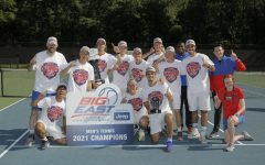 The DePaul men's tennis team celebrates together after winning the Big East Tournament April 26.