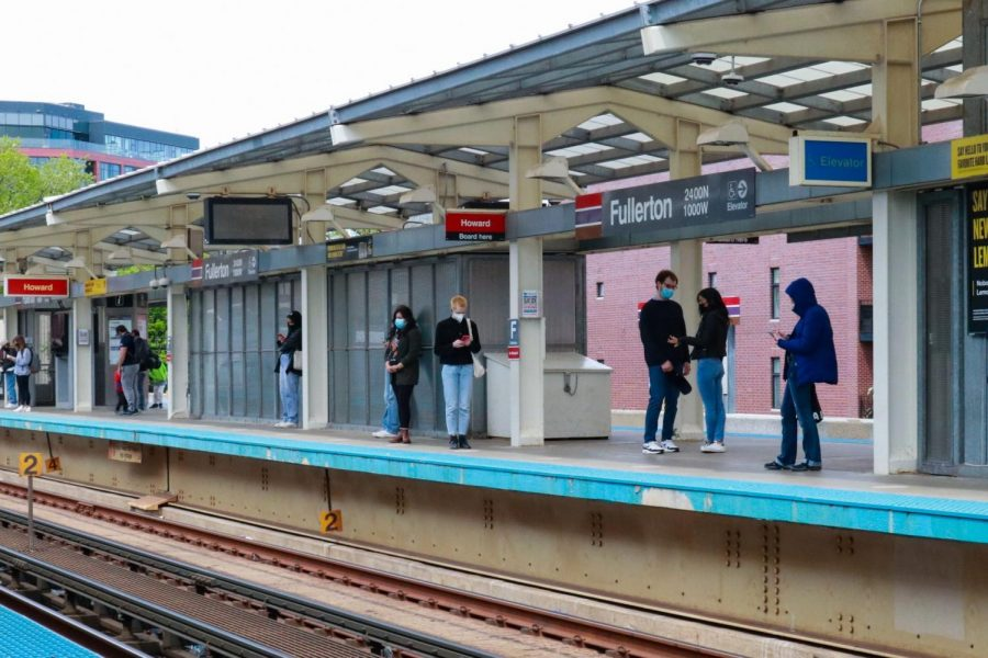 Commuters stand on the Fullerton CTA platform located near the Lincoln Park campus,  waiting for incoming Northbound trains.