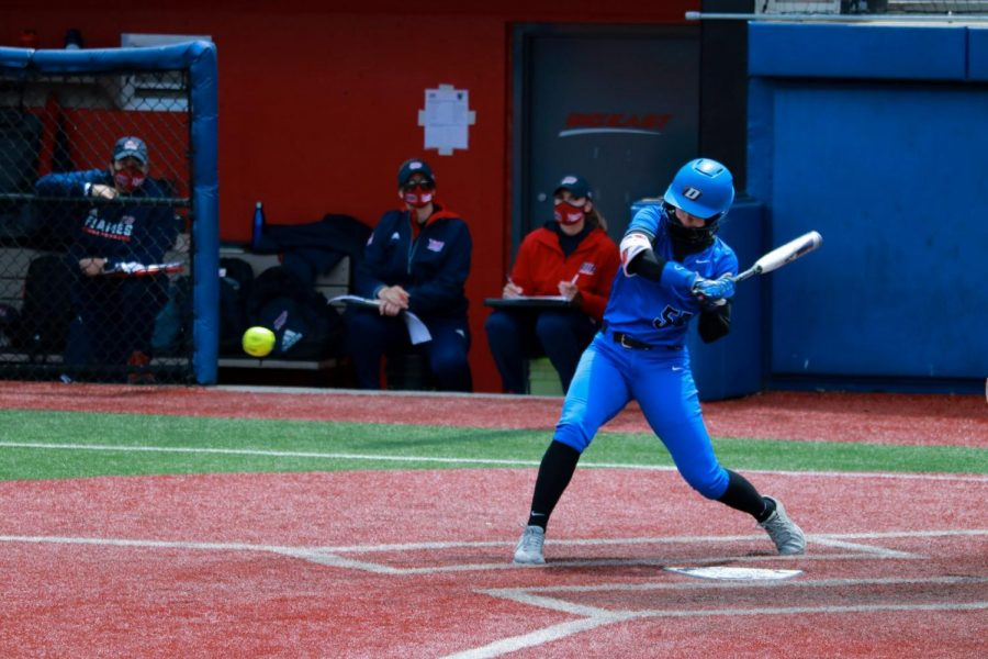 DePaul senior outfielder Angela Scalzitti prepares to hit the ball against UIC at Cacciatore Stadium on Saturday. The Blue Demons won all three games in the series.