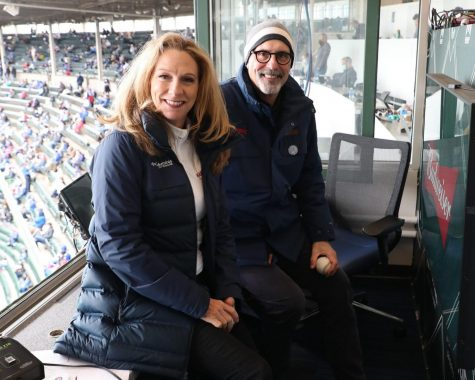 Beth Mowins and Jim Deshaies take a picture together during the Cubs' game against the Pirates at Wrigley Field.