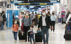 Henry Hernandez, his wife Karina Gonzalez and their children Jose Sebastian, 2, and Laura, 6, of Colombia, walk towards the baggage claim area at Miami International Airport, Friday, May 28, 2021, in Miami. The couple were surprised to be offered the Johnson & Johnson COVID-19 vaccine upon arrival to the U.S. It is their first overseas trip since the pandemic began last year. Florida's Emergency Management Agency is running the program through Sunday.