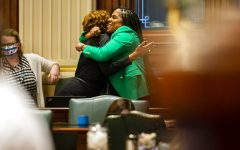 Illinois State Rep. Jehan Gordon-Booth, D-Peoria, right, hugs Illinois State Rep. Camille Lilly, D-Chicago, as they celebrate the passage of Senate Bill 818, the bill to update sex education standards in Illinois,on the floor of the Illinois House of Representatives at the Illinois State Capitol in Springfield, Ill., Friday, May 28, 2021. (Justin L. Fowler/The State Journal-Register via AP)