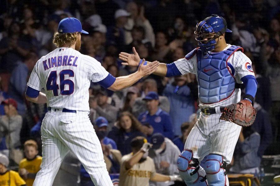 Cubs players Craig Kimbrel and Wilson Contreras High Fiving