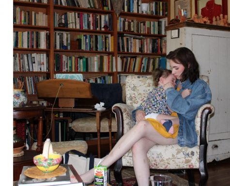 Emma and her daughter, Juniper, in a rocking chair at her former professor