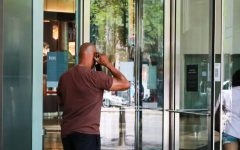 A man puts on his mask before entering Water Tower Place on June 4.