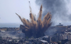 In this May 13, 2021, file photo, smoke rises following Israeli airstrikes on a building in Gaza City. Human Rights Watch on Tuesday, July 27, 2021, accused the Israeli military of carrying attacks that