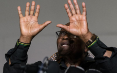 Former president Jacob Zuma gestures as he addresses the press at his home in Nkandla, KwaZulu-Natal Natal Province, Sunday, July 4, 2021. Zuma told hundreds of supporters gathered outside his rural estate that he is appealing his 15-month prison sentence and impending arrest by police. South Africa's top court, the Constitutional Court, last week sentenced Zuma to prison for defying a court order that he should testify before a commission investigating allegations of rampant corruption when he was president from 2009 to 2018. (AP Photo/Shiraaz Mohamed)