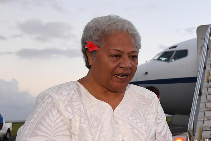 Then Deputy Prime Minister of Samoa Fiame Naomi Mata'afa speaks with Australian Prime Minister Malcolm Turnbull and the Australian High Commissioner to Samoa Sue Langford as they arrive at Faleolo Airport in Apia, Samoa on Sept. 8, 2017. More than three months after winning an election which sparked a constitutional crisis, Samoas first female prime minister was finally able to take office on Tuesday, July 27, 2021. (Lukas Coch/AAP Image via AP)
