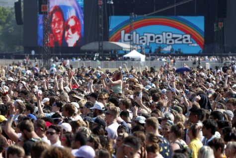 In this July 29, 2021 file photo, fans gather and cheer on day one of the Lollapalooza music festival at Grant Park in Chicago. (Shafkat Anowar/Associated Press)