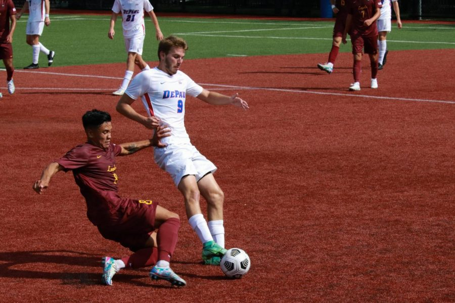 Sophomore forward Marek Gonda fights for a ball in the first half against Loyola.