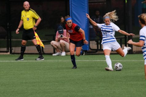 Sophomore defender Grace Phillpotts clears a ball on Sunday against UIC. The Blue Demons shut out the Flames 3-0.