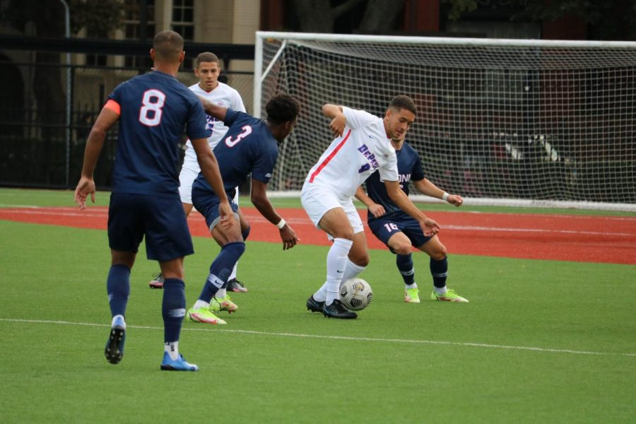 Midfielder Youssef Ramadan surrounded by Uconn defenders during their 2-1 win on Saturday.