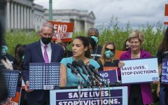 Rep. Alexandria Ocasio-Cortez, D-N.Y., speaks as she is joined by, from left, Sen. Ed Markey, D-Mass., Sen. Elizabeth Warren, D-Mass., and other progressive lawmakers to advocate for reimposing a nationwide eviction moratorium that lapsed last month, at the Capitol in Washington, Tuesday, Sept. 21, 2021. AP PHOTO