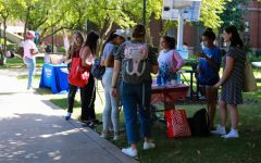DePaul students stop at the table for the DePaul Center for Jewish Life at the Involvement Fair on September 8, the first day of autumn quarter.