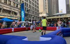 Kids play in the DePaul sponsored area of Sunday's on State.