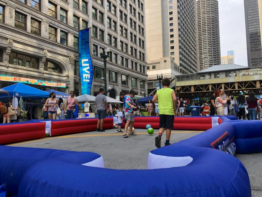 Kids play in the DePaul sponsored area of Sundays on State.