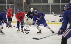 Players scrap over the puck during their scrimmage on Friday, Sept 24.