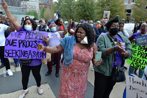 Haitian-Americans chant during a demonstration at the JFK Federal Building in Boston on Friday, Sept. 24, 2021. Members of Bostons sizable Haitian community staged a protest outside the Federal building to denounce the mistreatment of Haitian migrants at the border with Mexico. (AP Photo/Josh Reynolds)