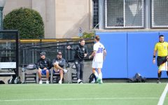 DePaul mens soccer coach Mark Plotkin talking to a player during their game against UConn on Sept 25.