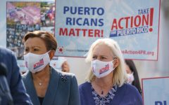Rep. Nydia Velazquez, left, and Sen. Kirsten Gillibrand join advocates for Puerto Rico at the Capitol in Washington on Sept. 20.
