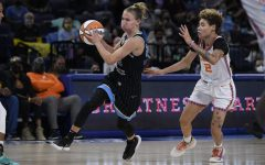 Chicago Skys Courtney Vandersloot (22) drives against Connecticut Suns Natisha Hiedeman (2) during the second half of Game 3 of a WNBA semifinal playoff basketball game Sunday, Oct. 3, 2021, in Chicago. Chicago won 86-83